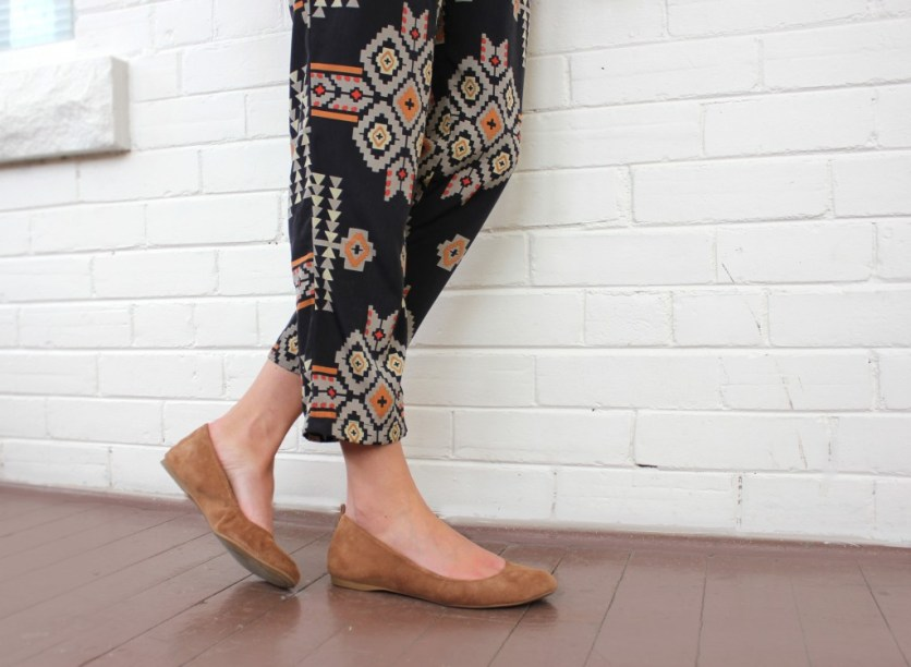 tribal pants and beige shoes.