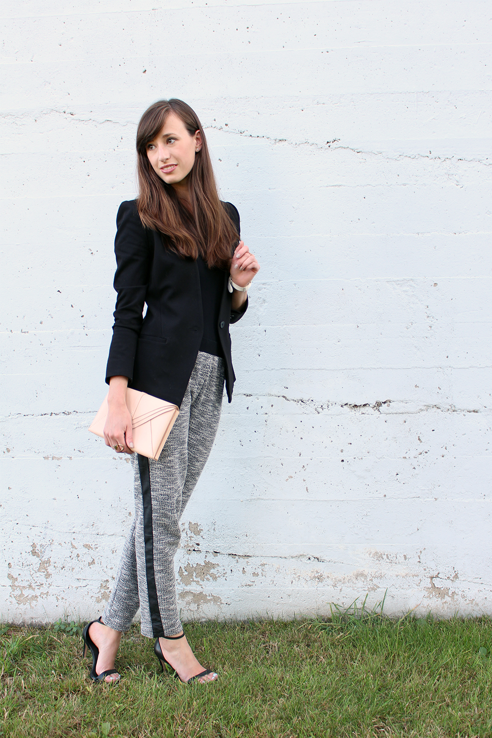 Style Bee wearing a black blazer and tuxedo pants.