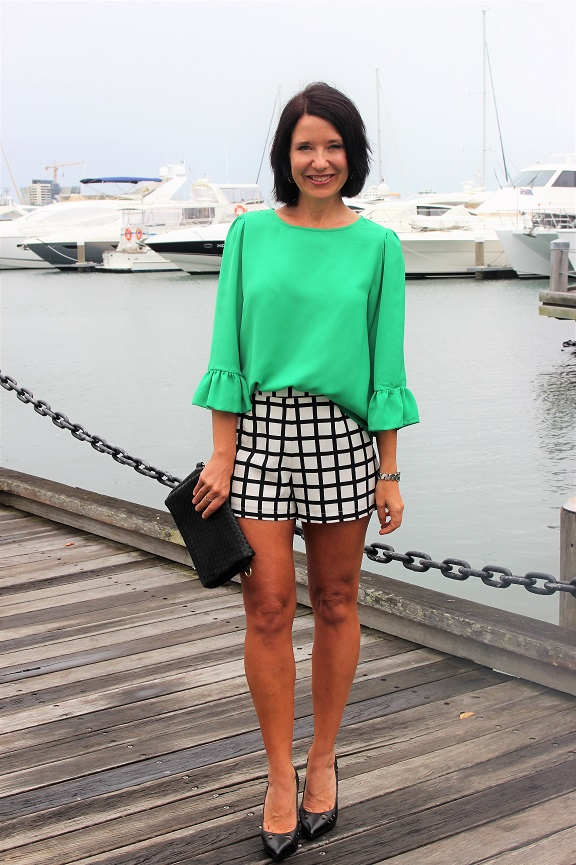 Green top and checked shorts