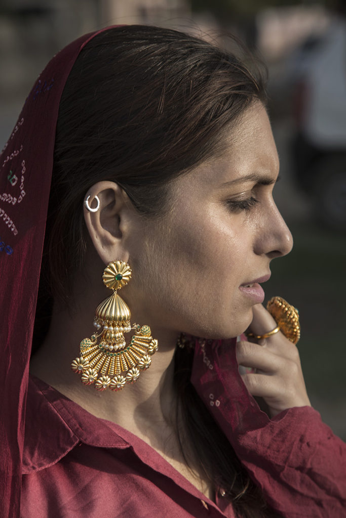 Gold Plated Silver Jhumkas With A Textured Peacock Motif