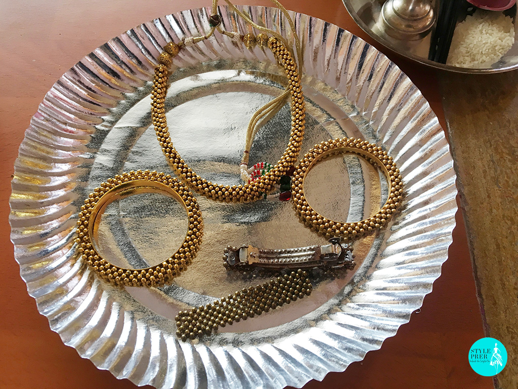 A Collection Of Golden Handwoven Beaded Necklace, Bangles And Hair Clip