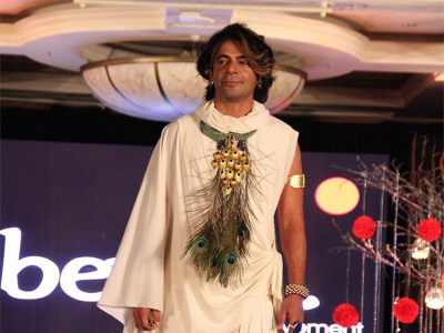 Sunil Grover wearing handmade Silver Necklace with real Peacock feathers from Adore, dressed as Lord Krishna at the Beti Foundation Jewelry and Fashion Show