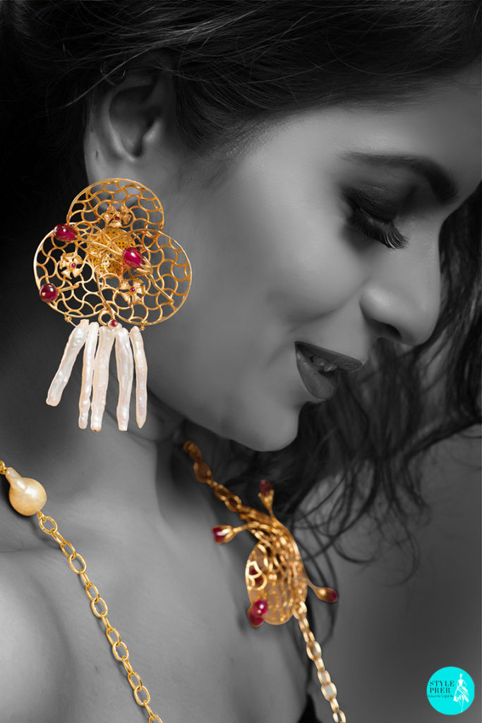 Inspired From The Jaalis And Architecture Of The Taj Mahal Are A Pair Of Gold Earrings With Ruby Buds And Pearl Hangings