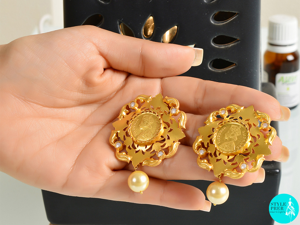 Gold plated silver earrings centered with a coin and filigree from the coin collection. Available on Velvetcase.com