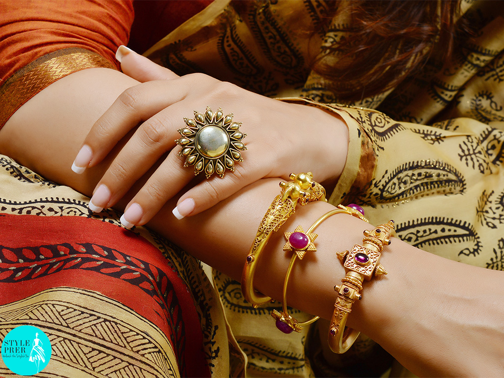 I often wear ethic, to style my look I chose layers of silver bangles and kadas that are gold plated and studded with gemstones, contrasting the look with a silver ring. Jewelry available on Velvetcase.com