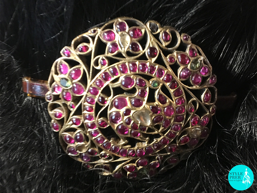 Known As Nakori In South India, The Hair Ornament Is Inherited By Usha's From Her Great Grandmother And Something That She Treasures. It Is Encrusted With Burmese Rubies, Golconda Diamonds And Emeralds. Not Only The Top But The Back Of The Ornament Has Beautiful Filigree.
