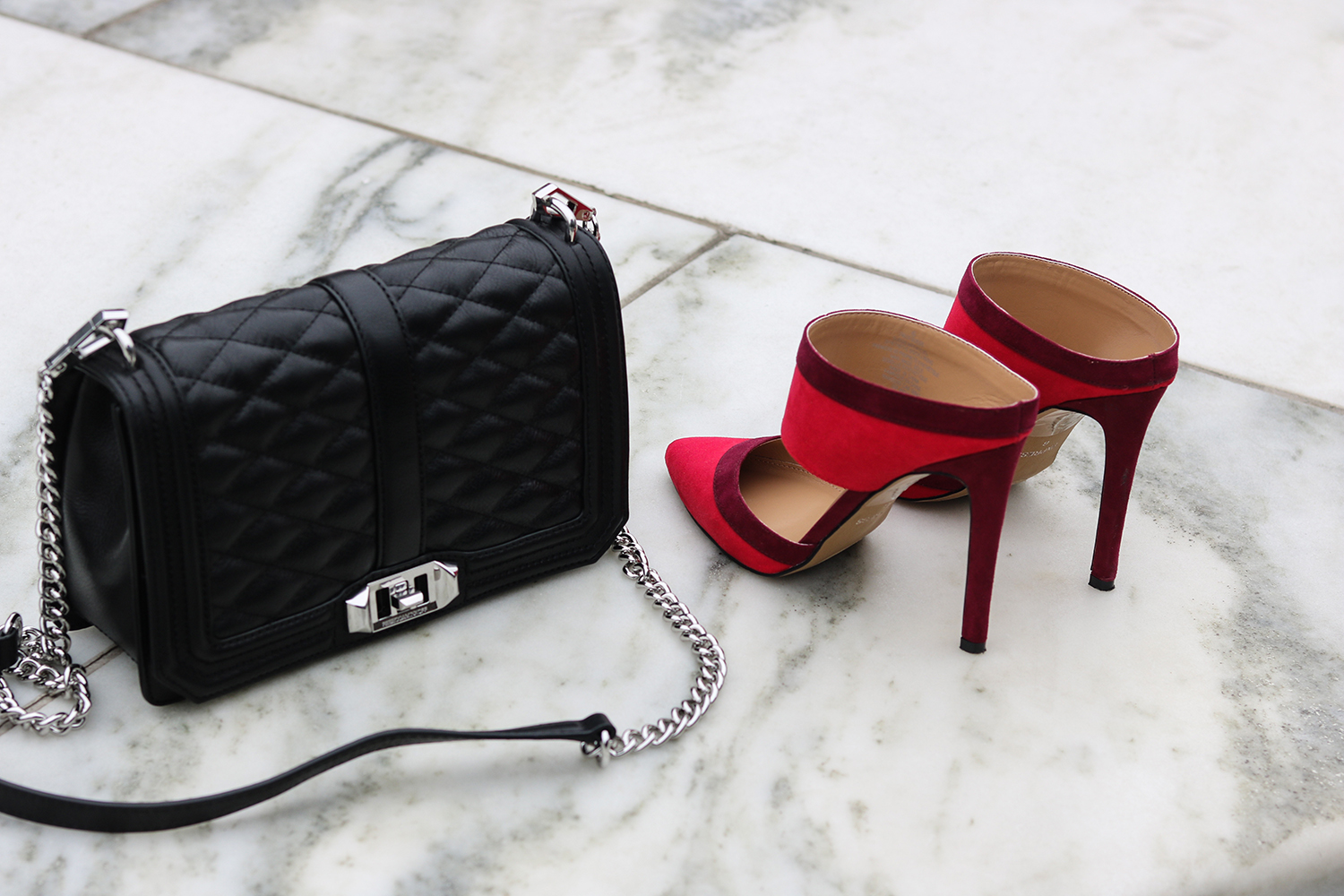 black quilted bag & red open back shoes