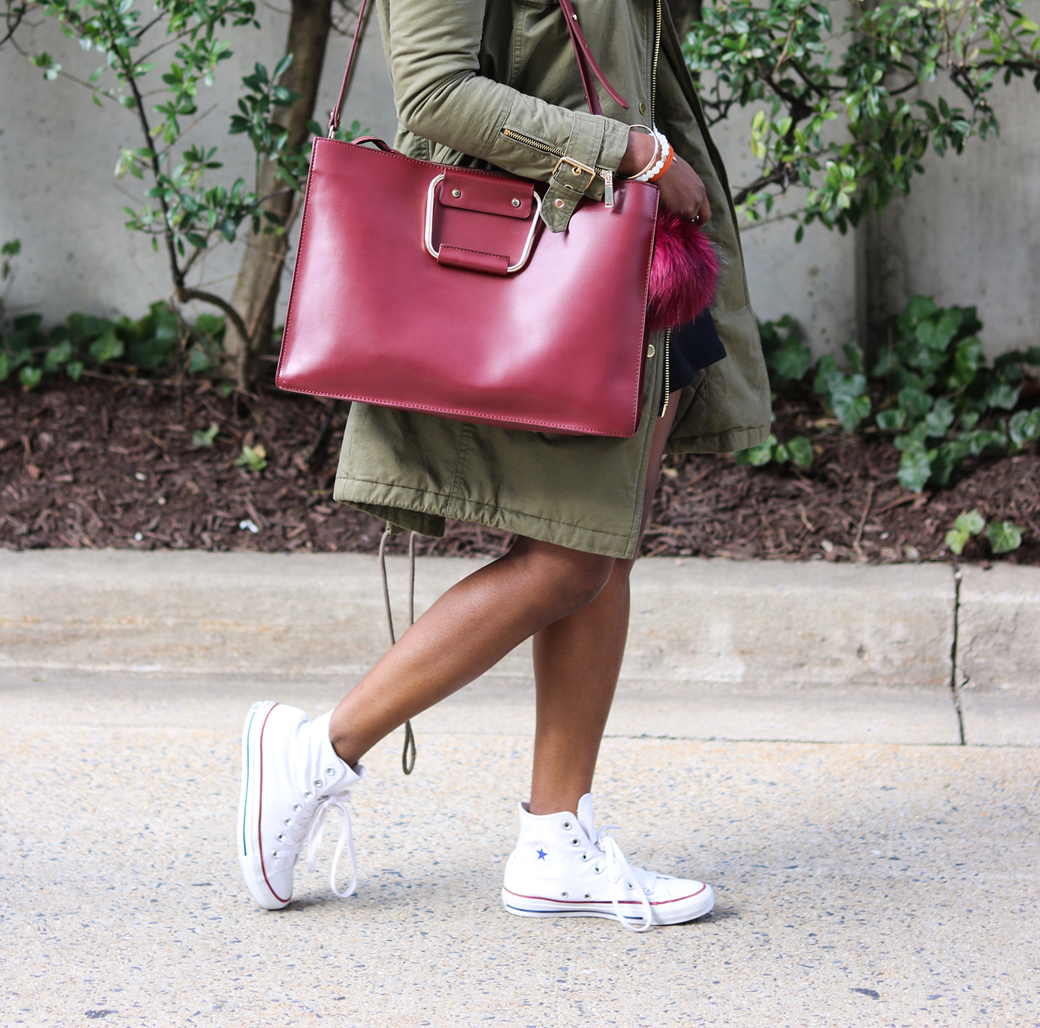 khaki parka and burgundy purse
