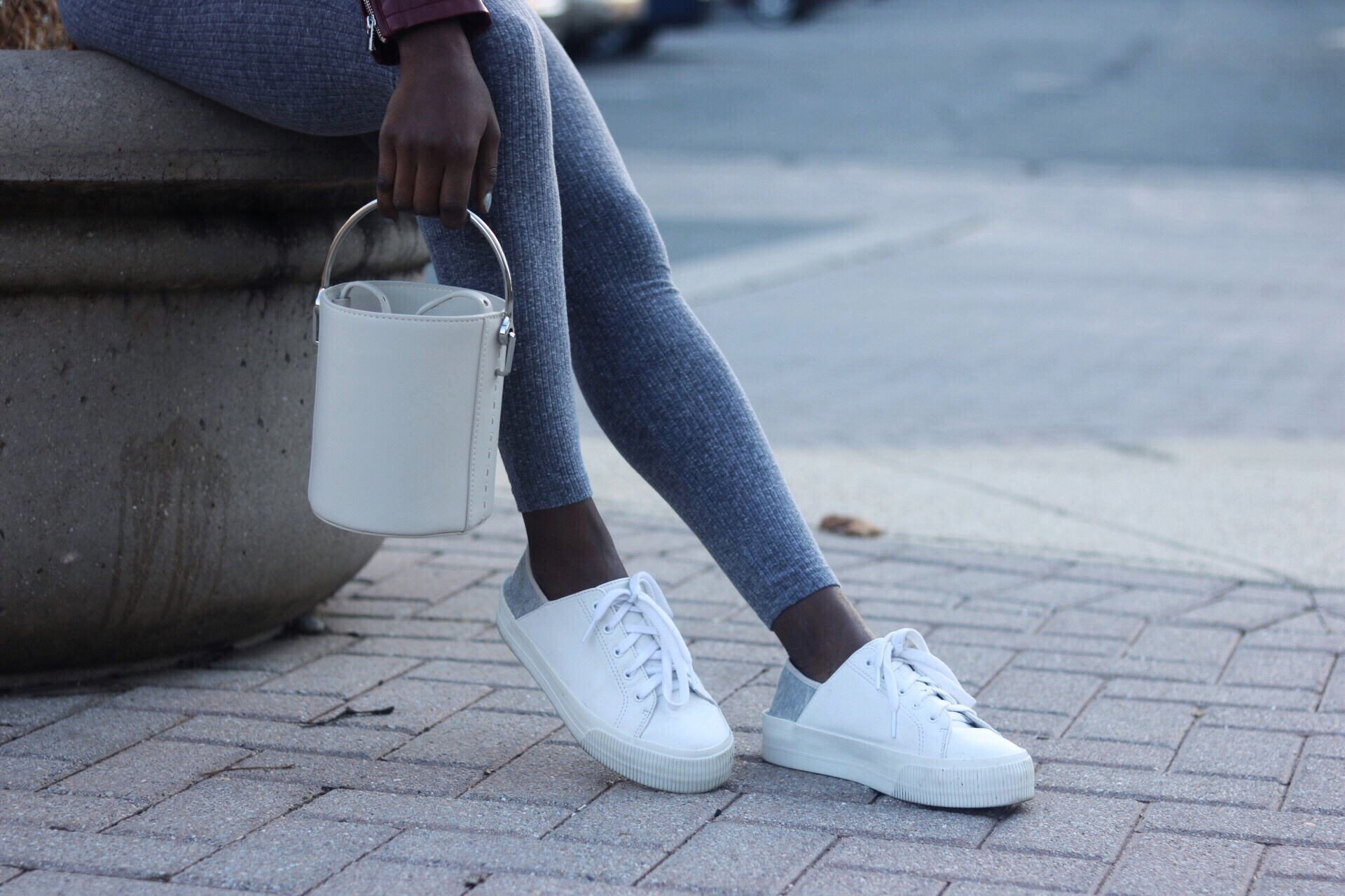 ALT= Jersey Jumpsuit and bucket bag with sneakers