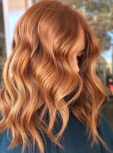 Perfect pairing of bronze hues and coppered curls