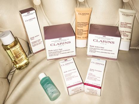 clarins beauty haul products laid on sofa