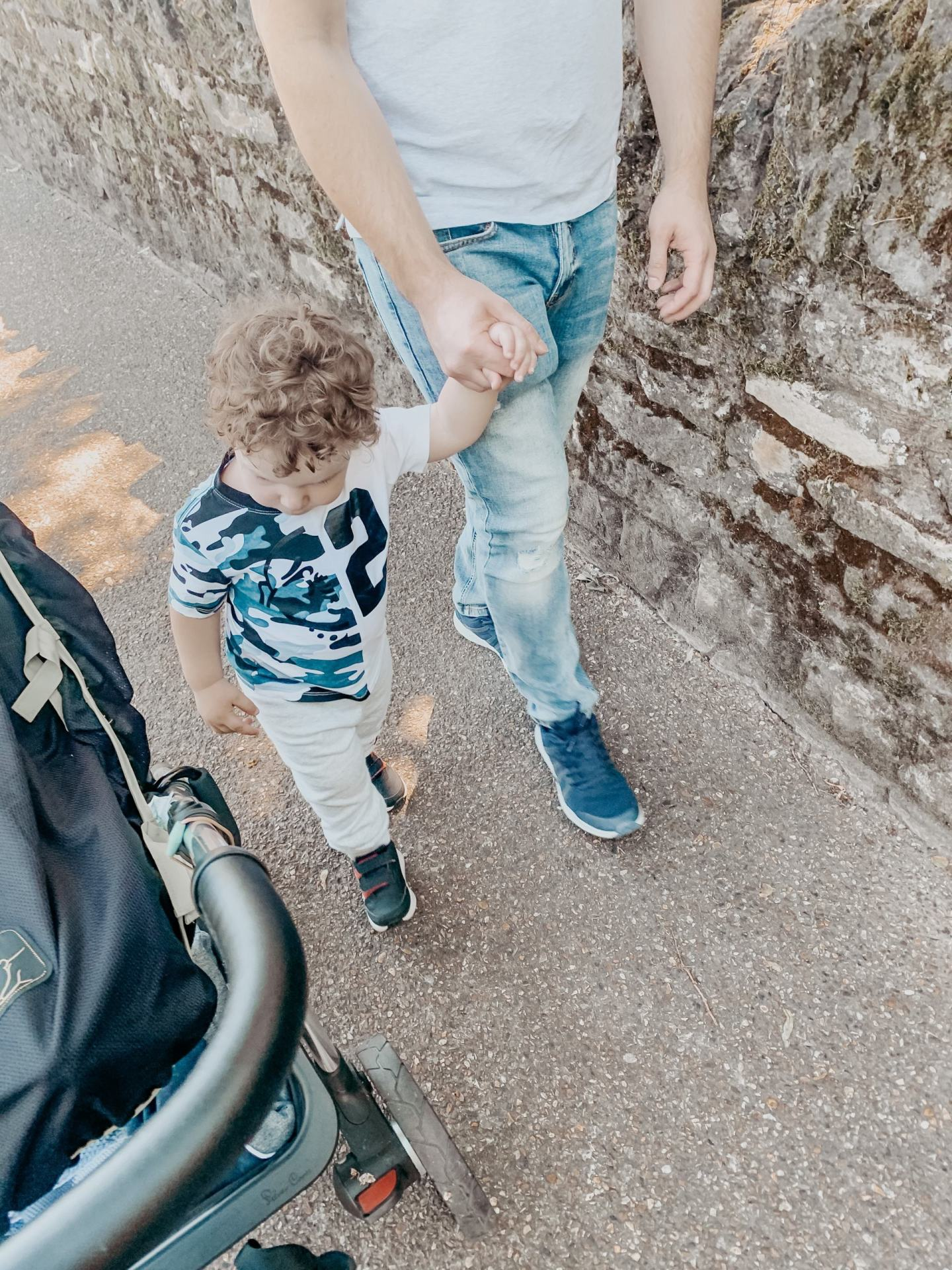 picture of child and father walking holding hands