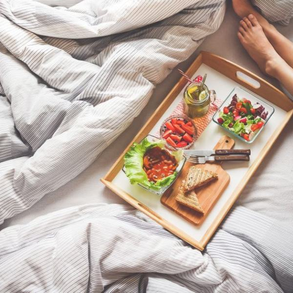 woman in bed with breakfast