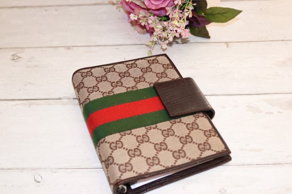gucci planner on desk