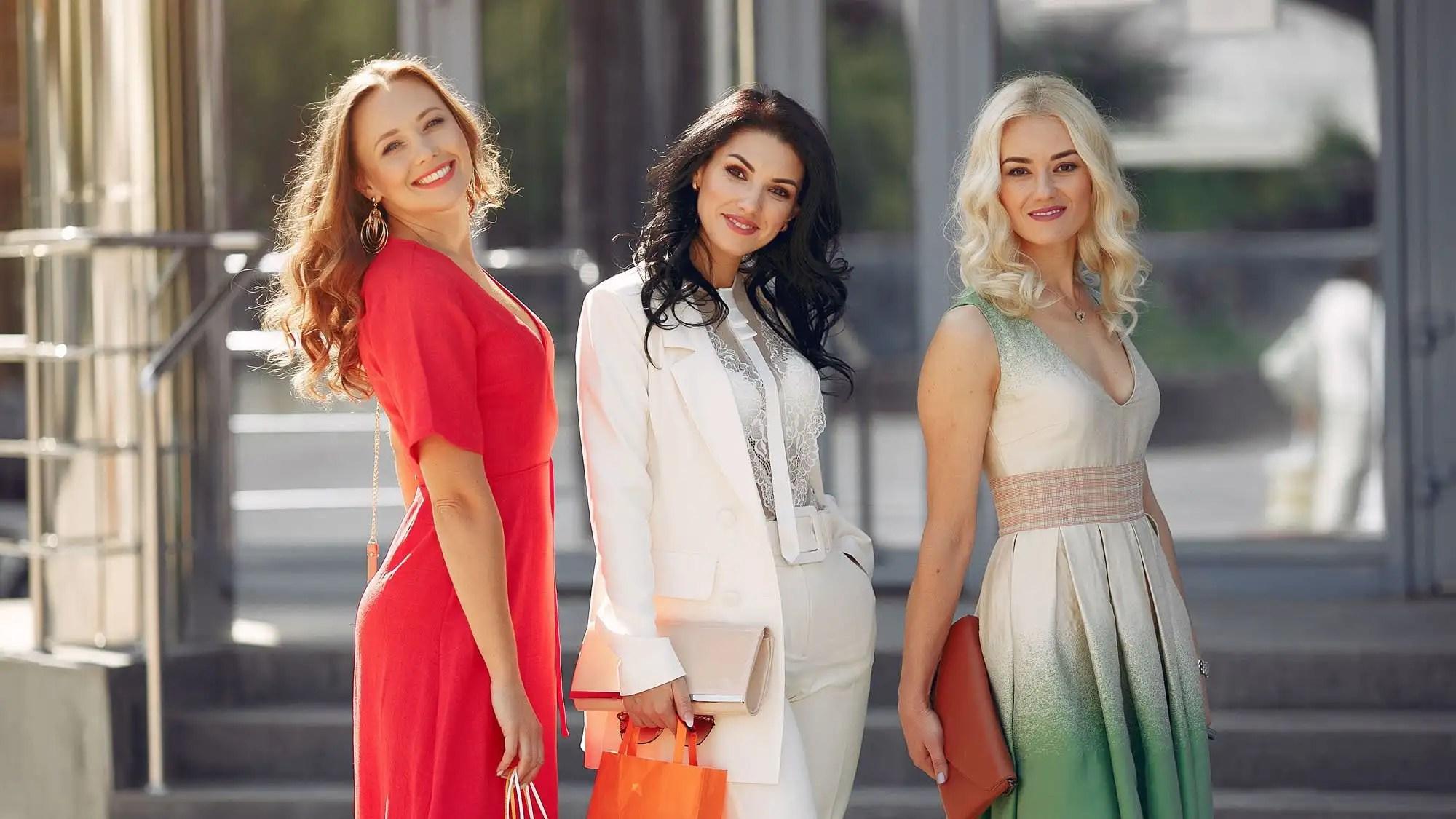 Women shopping. Three elegant woman in a city. Ladies in a stylish dress