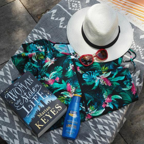Sunsoaked rashie | Blue Illusion hat | NIVEA Moisturising sunscreen | Miu-Miu sunglasses | Knotty beach towel | The women who stole my life by Marian Keyes