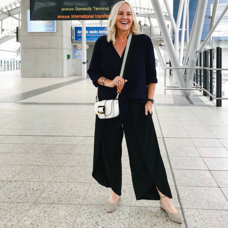 Travel style: Styling You The Label Cate shirt in navy; Maria pants in black   FRANKiE4 Footwear BEC flats in leopard