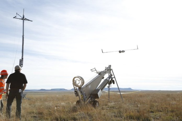 Insitu and BNSF officials launch ScanEagle for the historic first flight. (PRNewsFoto/Insitu, Inc.)