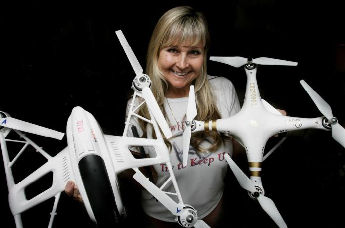 "Desiree Ekstein of Lake Elsinore, holds two of her drones and goes by the nickname ""Drone Diva Desi"" because she has no fewer than 10 drones in Lake Elsinore. on Tuesday, Jan.05, 2016."