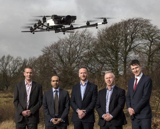 Picture by Christian Cooksey/CookseyPix.com on behalf of the Clydesdale Bank and the Big Partnership. For further information please contact Stephen McCrossan on 0141 3339 9585 Clydesdale Bank have announced funding for the expansion of Cyberhawk, who supply drones for companies around the world. Pictured at the Cyberhawk HQ in Livingston in with one of the Drones flying  are LtoR. Malcolm Connolly (Founder and Technical Director at Cyberhawk), Usman Ali from Clydesdale Bank, Craig Roberts (CEO Cyberhawk), David McIntyre (CFO Cyberhawk) and  Nick Edgar from Clydesdale Bank.   All rights reserved. For full terms and conditions see www.cookseypix.com