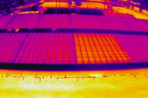 The lighter-colored solar panel is warmer and less efficient