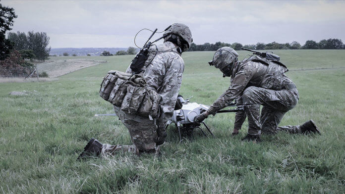 Elistair Orion UAV with Silvus ad hoc networking Soldiers
