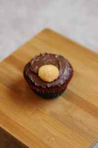 Brownie in Christmas cupcake liner with chocolate frosting and a Nilla wafer for a reindeer muzzle.