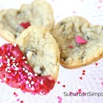 Heart shaped chocolate chip cookies dipped in melted chocolate and sprinkles.