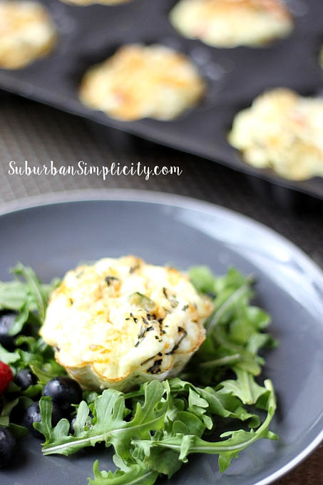 Mini Quinoa Frittata Plated with mixed greens.