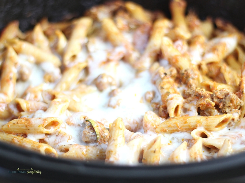 Crockpot Pizza Casserole is an easy weeknight dinner everyone LOVES! Simple and delicious every time. It's even great leftover for lunch the next day!