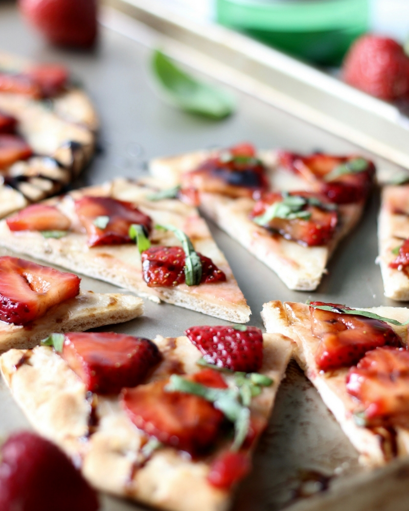 Strawberry Balsamic Flatbread is an easy recipe with lots of sweet and savory flavors. The perfect summer appetizer or snack!