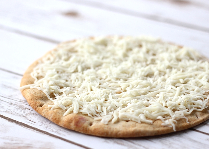 Whole wheat flatbread topped with mozzarella cheese.