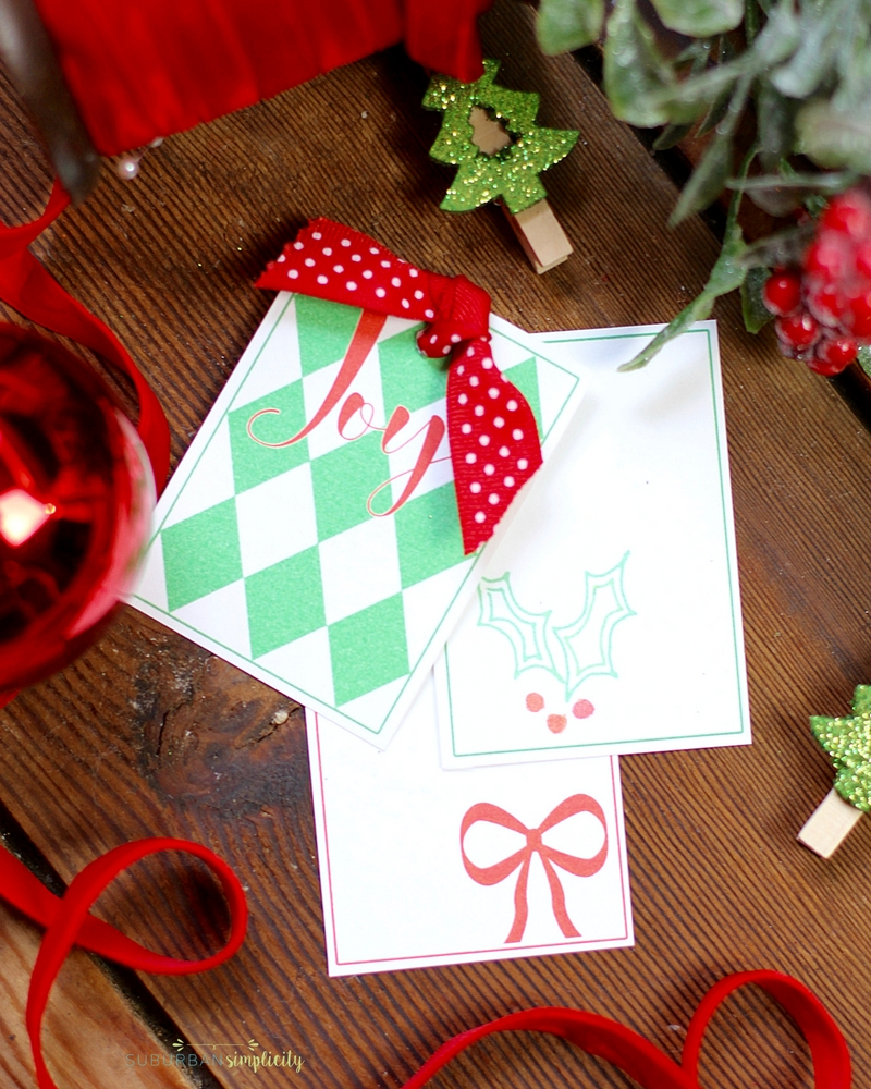 Top your gifts with these Free Printable Christmas Gift Tags for a personal touch.  This holiday DIY is just what you need to make your presents festive and bright! #Christmas #printables