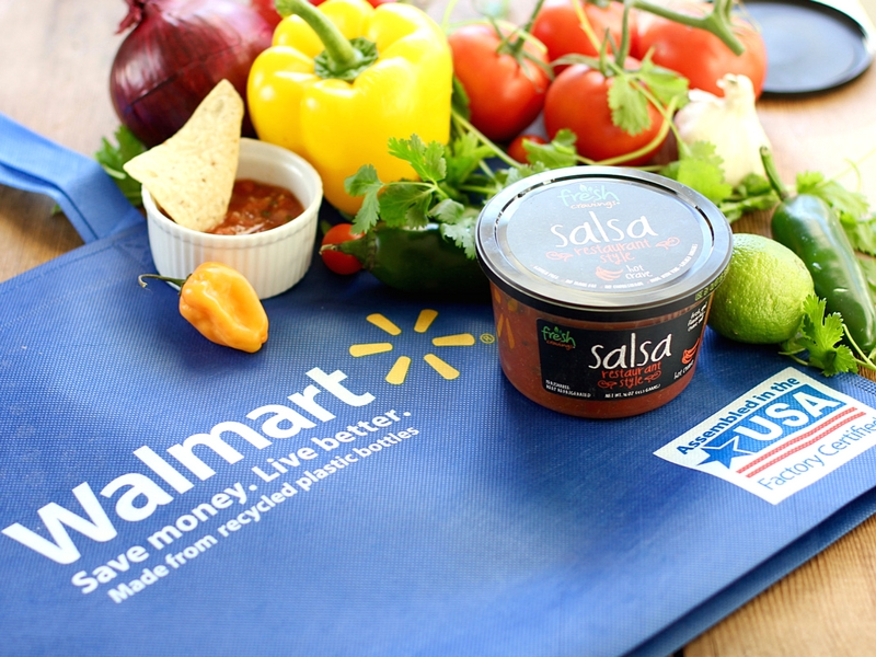 Walmart bag next to fresh salsa and fresh vegetables and peppers.
