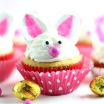 Bunny Cupcakes with pink cupcakes liners and Butterfinger NestEgg candy next to them.