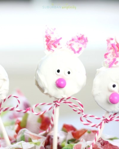 An adorable Easter bunny Oreo cookie pop with a ribbon around the stick.