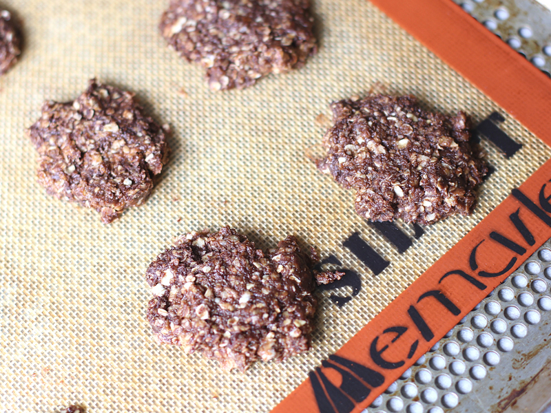 Chocolate no bake cookies on a silicone baking mat.