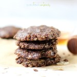 Healthy no bake cookies stacked with honey in the background.