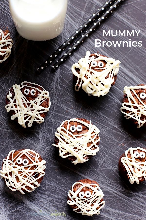 These Mummy Brownies are perfect for Halloween!  They'll scare up a good time and they're so easy to make! The perfect kid-friendly treat!