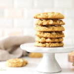 Pumpkin spice cookies stacked on a cake stand.