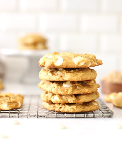 Pumpkin spice cookies stacked on a cooling rack.