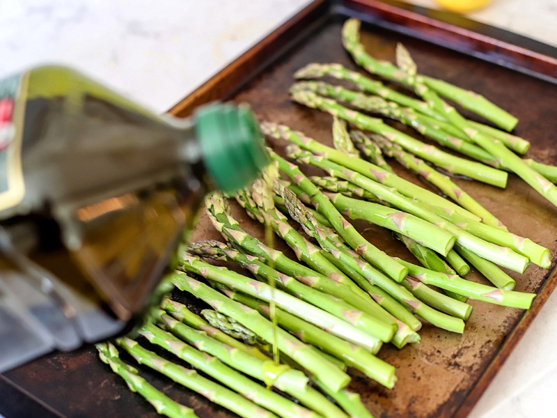 Roasted asparagus being prepped for the oven.