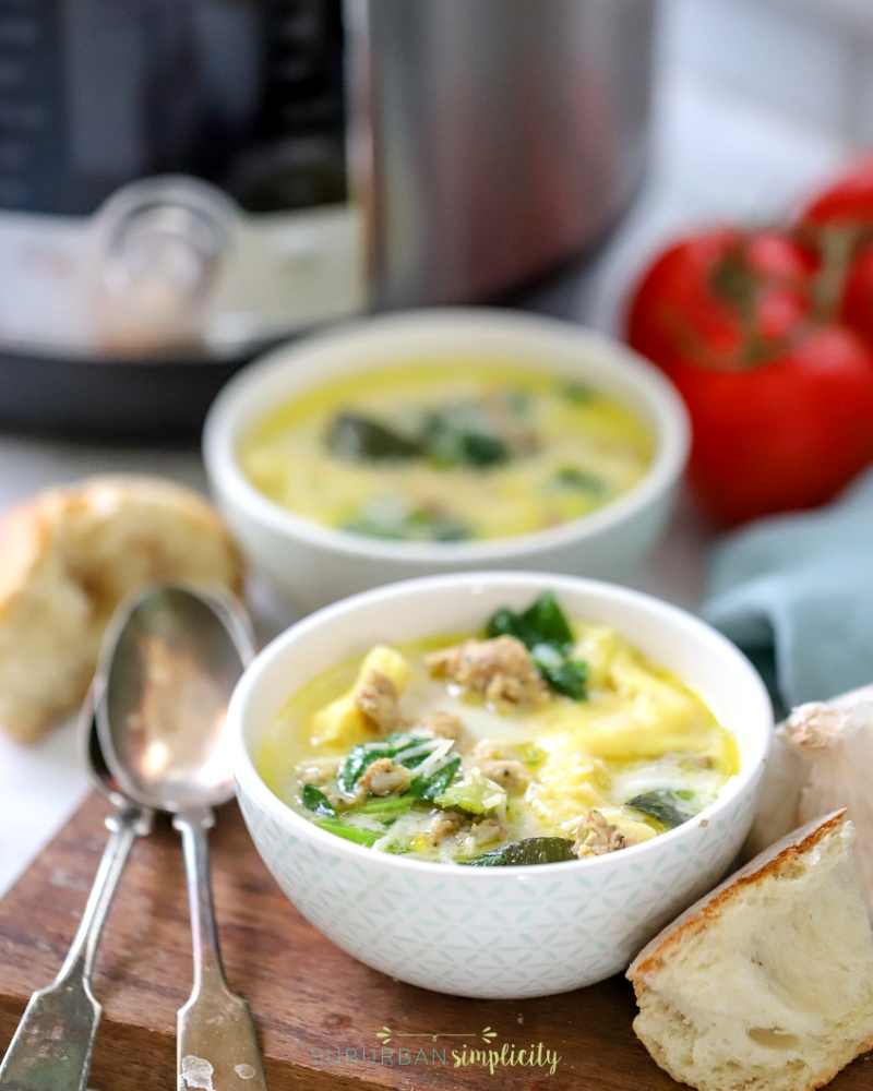 Two bowls of Instant Pot Tortellini Soup.