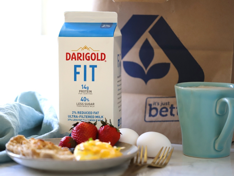 Darigold FIT milk next to a sausage and cheese omelet.