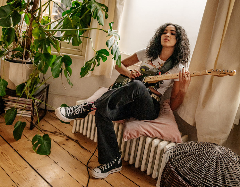 Musician Aziya Playing Guitar
