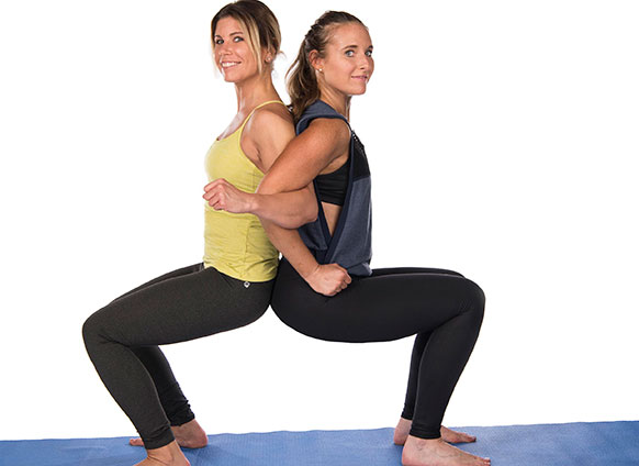 buddy up and try these 2 person yoga poses