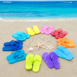 Colored flip flops on beach