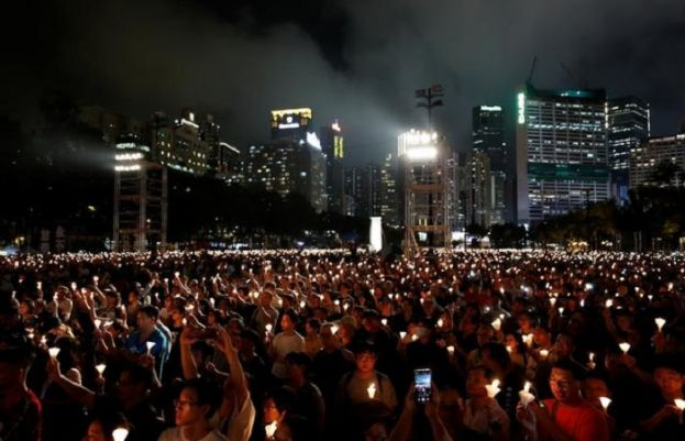Hong Kong holds somber Tiananmen vigil as Beijing goes into lockdown