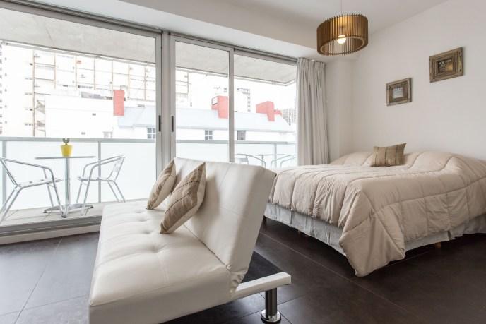 Apartemento amoblado con balcon superior sillon cama vista