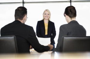 business woman being interviewed by business peopl